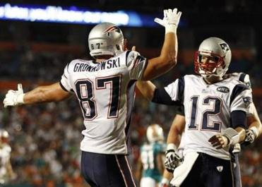 Rob Gronkowski, left, celebrates with Brady after scoring a touchdown.